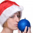Close up portrait of girl in santa claus hat and decoration ball — Stock Photo