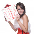Woman in santa dress with gifts - Stock Photo