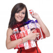 Woman in santa dress with gifts — Stock Photo