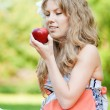 Beautiful woman with red apple — Stock Photo
