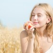 Happy woman on picnic in wheat field — Stock Photo