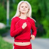 Beautiful woman running in park — Stock Photo