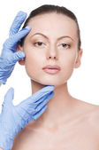 Beautician touch and exam health woman face — Foto Stock