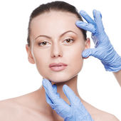 Beautician touch and exam health woman face — Stock Photo