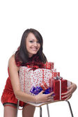 Close up portrait of girl in santa dress with gifts — Stock Photo