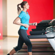 Gym exercising. Run on on a machine. — Stock Photo #8648869