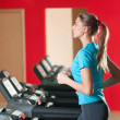 Gym exercising. Run on on a machine. — Stockfoto