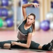 Woman doing stretching fitness exercise at sport gym. Yoga — Stock Photo #8648980