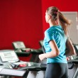 Stock Photo: Gym exercising. Run on on a machine.
