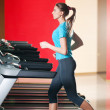Gym exercising. Run on on a machine. — Stock Photo #8649007