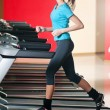 Gym exercising. Run on on a machine. — Stock Photo #8649019