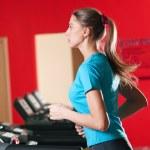 Gym exercising. Run on on a machine. — Stock Photo #8649047