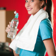 Woman at the gym drinking water — Stock Photo #8649049