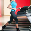 Gym exercising. Run on on a machine. — Stock Photo