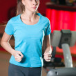 Gym exercising. Run on on a machine. — Stock Photo #8649063