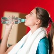 Woman at the gym drinking water — Stock Photo #8649106