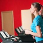 Gym exercising. Run on on a machine. — Stock Photo