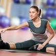 Woman doing stretching fitness exercise at sport gym. Yoga — Stock Photo