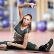 Woman doing stretching fitness exercise at sport gym. Yoga - Lizenzfreies Foto