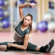 Woman doing stretching fitness exercise at sport gym. Yoga - Foto Stock