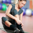 Woman doing stretching fitness exercise at sport gym. Yoga - Stock Photo