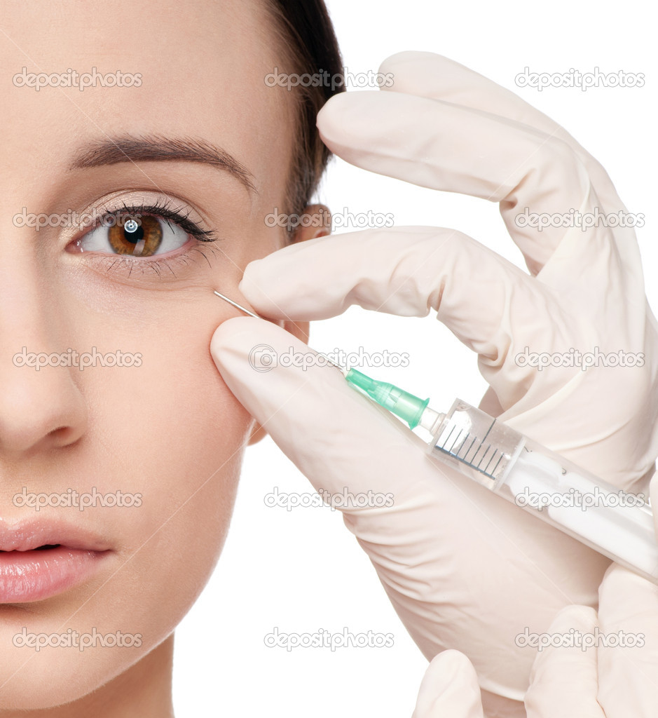 Cosmetic botox injection in the female face. Eye zone. Isolated  Stock Photo #8640821