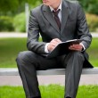 Business man working with papers at park. Student — Stock Photo #8650835