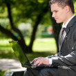 Business man work on notebook at park. Student — Stock Photo #8650847