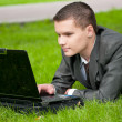 Business man work on notebook at park. Student — Stock Photo #8650852