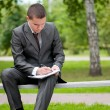 Business man working with papers at park. Student — Stock Photo #8650866