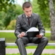 Business man working with papers at park. Student — Stock Photo #8650922