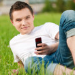 Young guy talking on mobile phone — Stock Photo