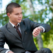 Business man waiting at park. Watch. Student — Stock Photo #8651025