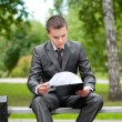 Business man working with papers at park. Student — Stock Photo #8651041
