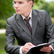 Business man working with papers at park. Student — Stock Photo #8651102
