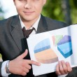 Business man show graph at park. Student — Stock Photo #8651145