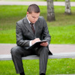 Business man working with papers at park. Student — Stock Photo
