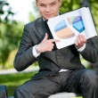 Business man show graph at park. Student — Stock Photo #8651197