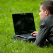 Business man work on notebook at park. Student — Stock Photo