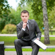 Business man working with papers at park. Student — Stock Photo #8651256