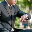Business man waiting at park. Watch. Student — Stock Photo
