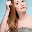Close up portrait of young beautiful woman with comb — Stock Photo