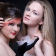Closeup portrait of two girls: good & evil — Stock Photo