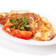 Omelet with herbs and tomatoes — Stock Photo