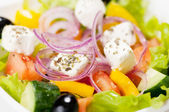 Greek salad on the white background — Stock Photo