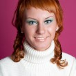 Portrait of a red-haired girl in a white sweater — Stock Photo #8173382