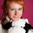 Portrait of a red-haired girl in a white sweater with a soft toy — Stock Photo #8173398