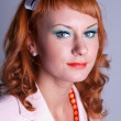 Portrait of a red-haired girl in a white suit — Stock Photo #8179038