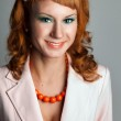 Portrait of a red-haired girl in a white suit — Stock Photo #8220921