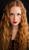 Red-haired girl with red lips — Stock Photo